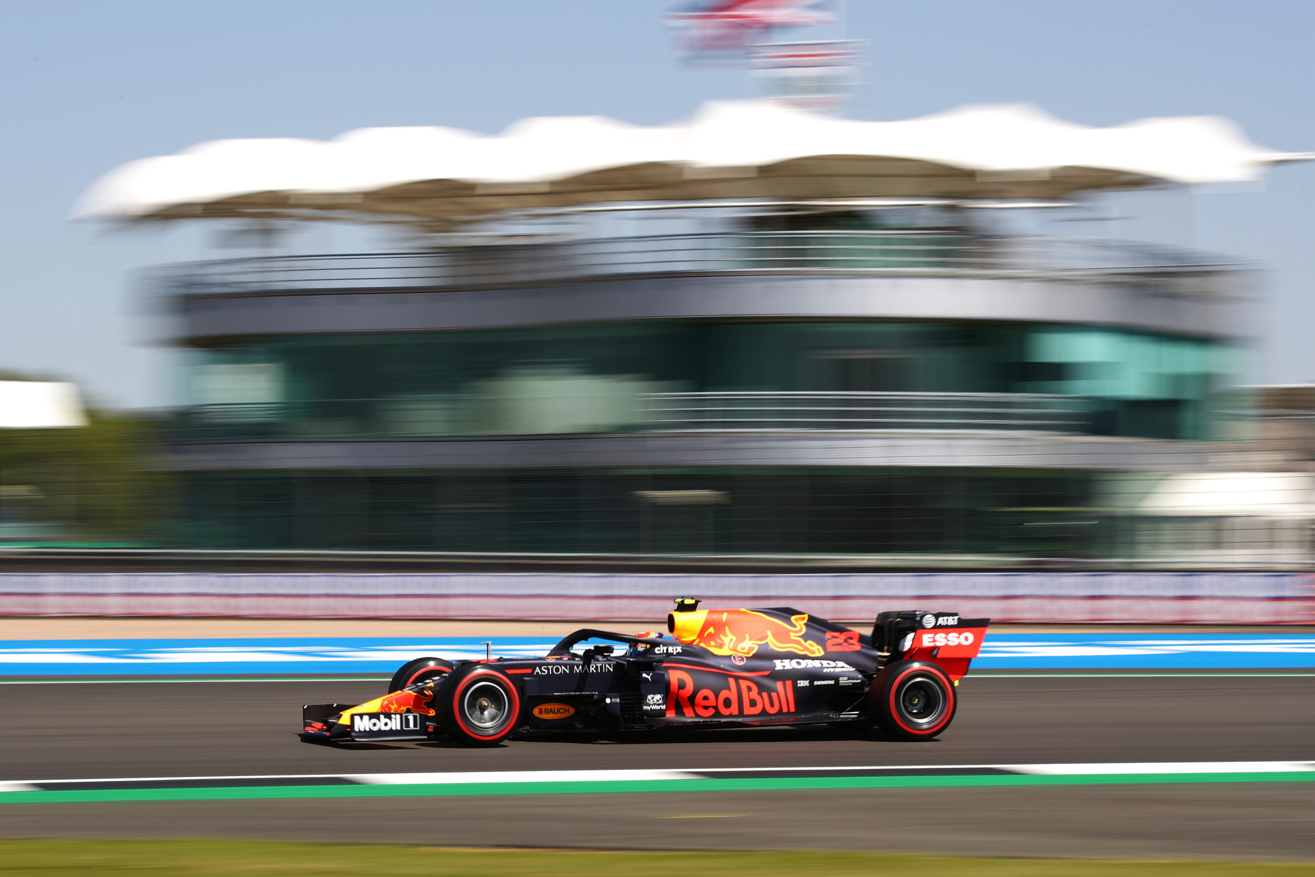 NORTHAMPTON, ENGLAND - JULY 31: Alexander Albon of Thailand driving the (23) Aston Martin Red Bull Racing RB16 on track during practice for the F1 Grand Prix of Great Britain at Silverstone on July 31, 2020 in Northampton, England. (Photo by Bryn Lennon/Getty Images) // Getty Images / Red Bull Content Pool  // AP-24T15DPX52111 // Usage for editorial use only //