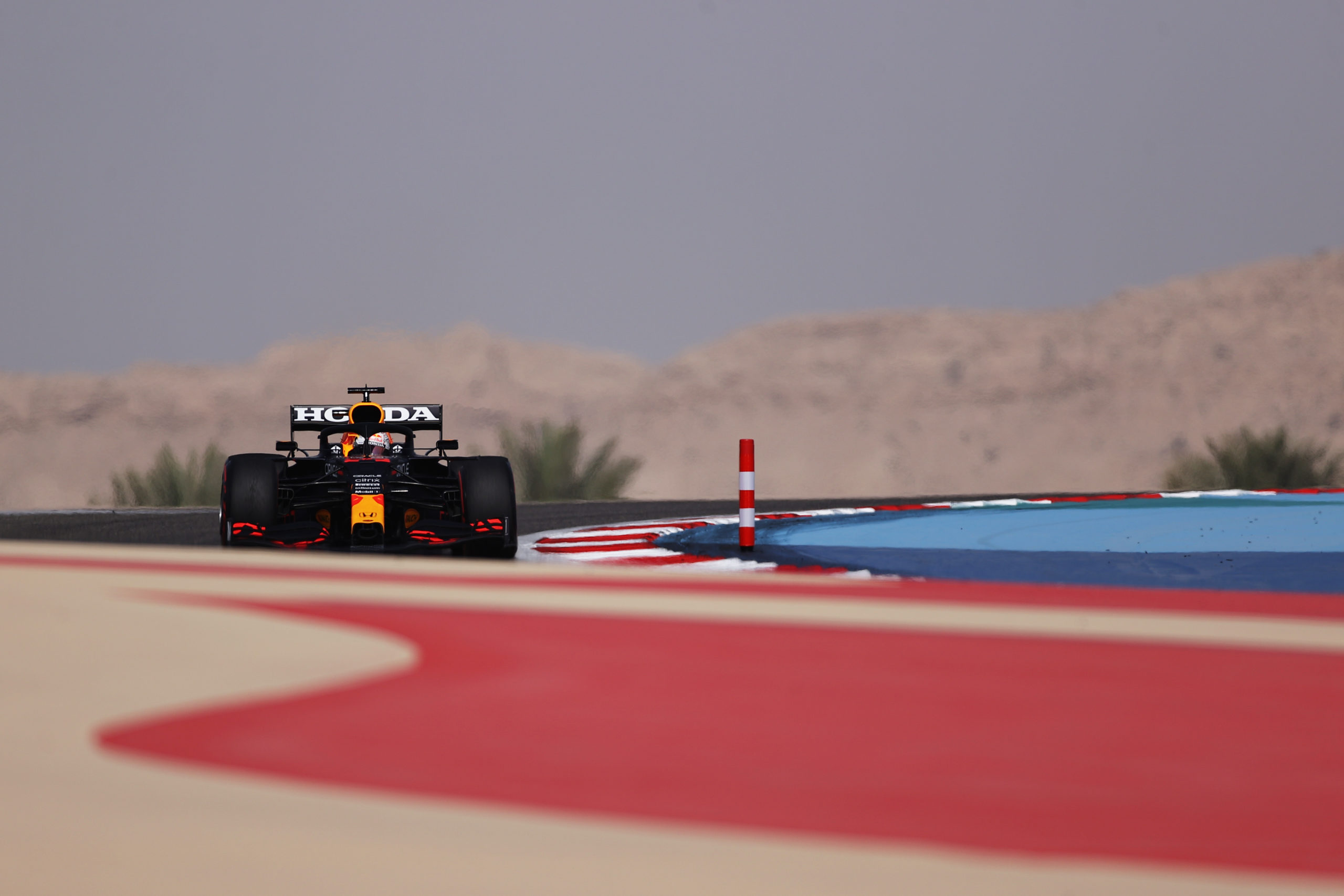 BAHRAIN, BAHRAIN - MARCH 26: Max Verstappen of the Netherlands driving the (33) Red Bull Racing RB16B Honda drives on track during practice ahead of the F1 Grand Prix of Bahrain at Bahrain International Circuit on March 26, 2021 in Bahrain, Bahrain. (Photo by Lars Baron/Getty Images) // Getty Images / Red Bull Content Pool  // SI202103260614 // Usage for editorial use only //